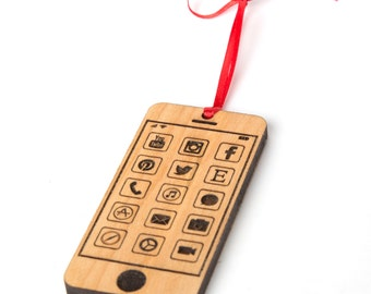 iphone inspired christmas ornament personalized on back. Solid wood iPhone ornament with apps. Laser engraved smartphone with name