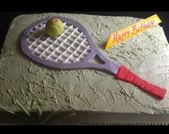 Fondant sugar tennis racquet and tennis ball