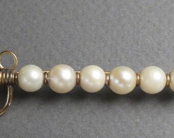 10Kt gold and natural pearls sword bar pin