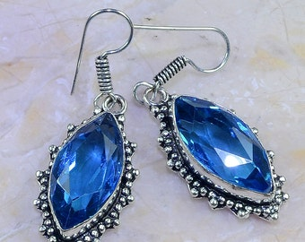 "Faceted Blue Topaz Sterling Silver 2"" Dangle Earrings"