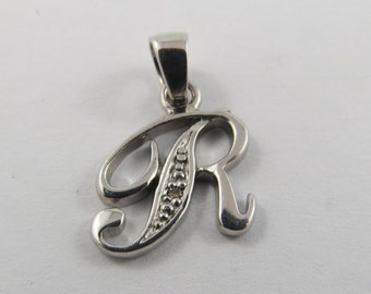 The initial R  Sterling Silver Charm.