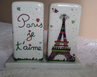 Souvenir of Paris salt and pepper on little tray. Whimsically decorated with the Eiffel Tower, Le Sacre Coeur and the Arc de Triomphe