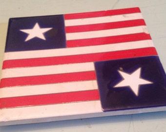 Vintage (c.1980s) Besheer Art Tile/Trivet.  Stars and Stripes design with cork back.  Made in USA.