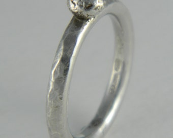 Hammered silver ring with silver ball