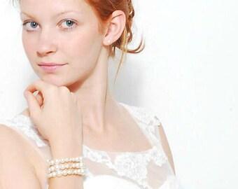 Wrap bracelet with glass beads.