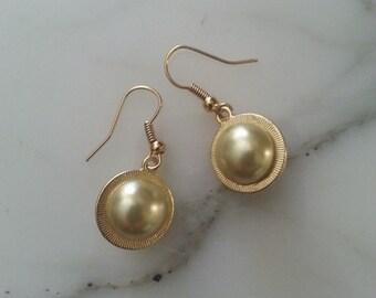 Button earrings, 1960s pearl