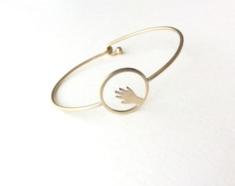 NU II. Bracelet champagne gold circle and small hand, unique piece handmade.