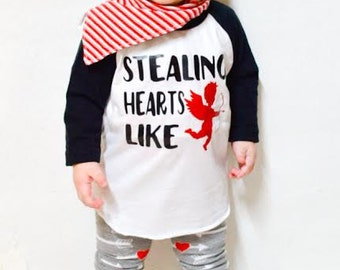 baby boy valentines day shirt, stealing hearts like cupid, first Valentines day outfit, valentines baby, v-day raglan, boy baseball tee