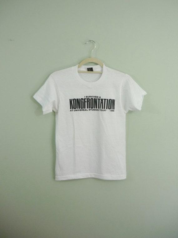 "1986 ""I Survived a Kongfrontation"" Tee / Universal Studios Souvernir Shirt / 1980s T-shirt / Modern XS or Children's"