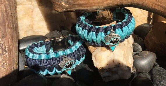 Carolina Panthers Paracord Bracelet, with a Panthers logo charm, and a stainless steel metal buckle