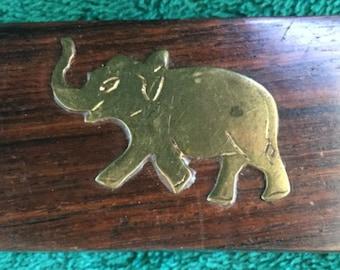 tiny teak box with brass artwork