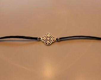 Bracelet argenté/doré et noir