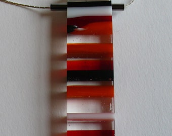 Fused glass bar pendant, stripes, layered, orange, white, black