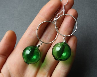 Earrings. Blown gollow green glass