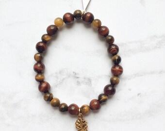 Tïg bracelet /// Tiger Eye beads and gold pineapple charm