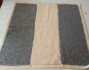 Grey and pink knitted baby blanket
