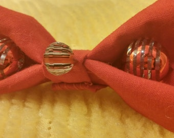 Small red cotton beaded designed hand sewn hair bow