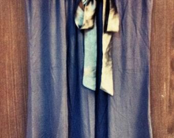 Gray tunic with a satin ribbon belt.