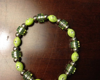 Green handmade bracelet with silver accent
