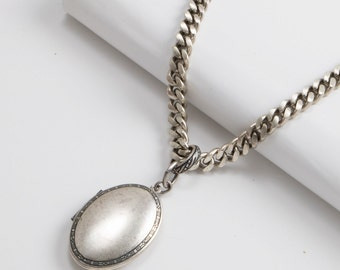 Oval Locket on Heavy Curb Chain
