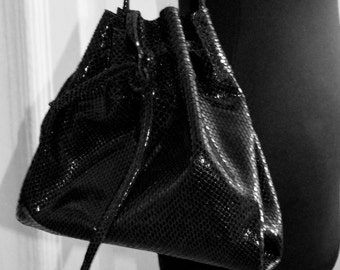 LITTLE SHINY black leather clutch-pouch