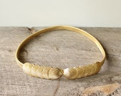 gold seashell stretch belt . skinny gold belt . vintage 70s 80s belt by Mimi Di N