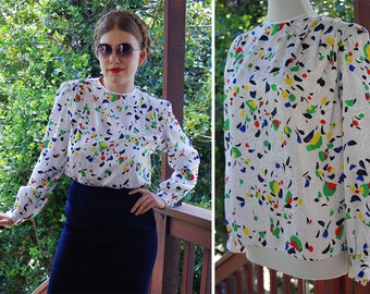 CONFETTI 1970's 80's Vintage Pearl White Secretary Blouse with Primary Color Splashes // by Eva LAUREL // size