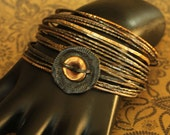 hippie chick BANGLE stack... vintage reworked bangles and smashed button for that boho gypsy style