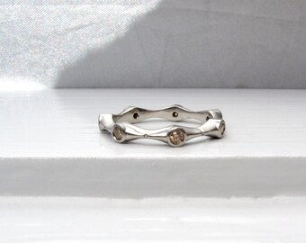 Cognac diamond and palladium eternity ring bezel set tawny brown diamonds