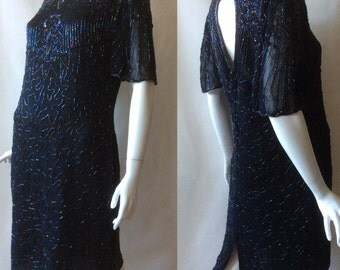 Vintage beaded black silky dress, 1980's in a 1920's style, with scalloped bell sleeves, keyhole open back, knee length, medium / large
