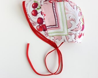 BEATRIX JONES ---x--- Little people sun Bonnet. limited edition . 'Red Cherry Pie' made from vintage tablecloth - Mini, 6 - 12mths, 2-4yrs