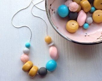 confectioner's necklace - vintage lucite - candy colored - aqua turquoise ochre pink