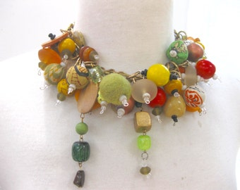 Short necklace using a jumble of beads-colorful-wood,resin,wool,fabric beads. Jumbled look,light weight.