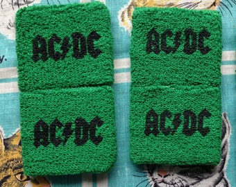70's, 80's AC/DC green terrycloth wristbands, sweatbands.