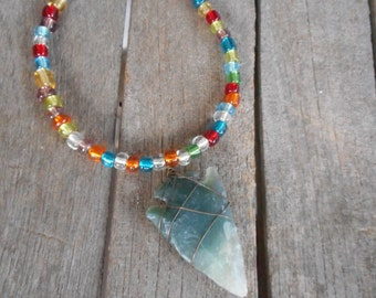 The Rainbow Warrior Bracelet. Stone Arrowhead & multicolored glass seed bead beaded hand strung Pride Bracelet.
