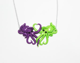 glow in the dark, green and purple octopus necklace, intertwined, octopi in love, translucent, opalescent, sparkly, glitter, spots, pastel