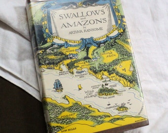 Swallows and Amazons by Arthur Ransome Illustrated by Helene Carter