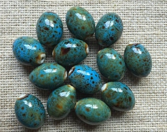 ON SALE Speckled Teal Ceramic Beads - 13