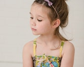 the Avery- a small vintage purple velvet bow attached to a thin nylon headband, hair accessory