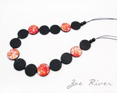 Long red and black wooden necklace with traditional Japanese paper