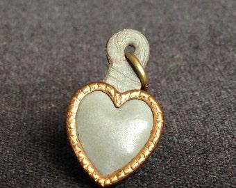 Vintage leather heart pendant.