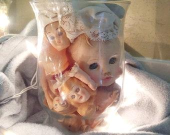 Doll Heads in a Hurricane