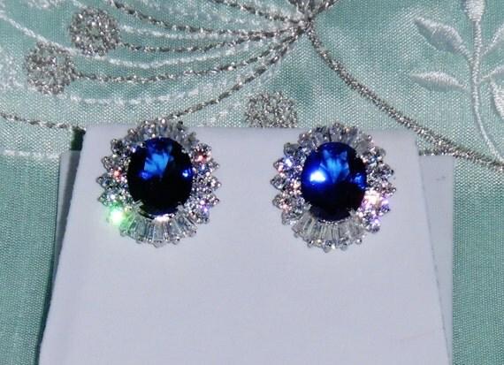 45 TCW Natural 10 x 12mm Swiss Blue Topaz gemstones, 14kt White gold Stud Earrings