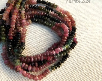 "Tourmaline spacer beads, 15"" strand of graduated colors"