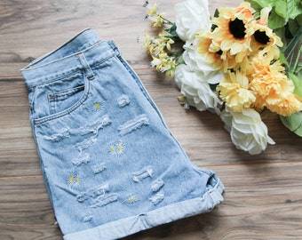 High waist vintage denim shorts | Ripped distressed shorts | Embroidered daisy flower denim | Floral denim shorts | Festival bohemian shorts