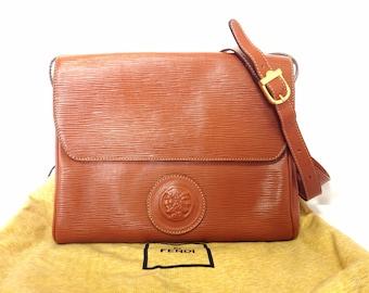Vintage FENDI brown epi leather messenger bag, shoulder purse with iconic Janus medallion embossed motif at front. Unisex. Rare bag.