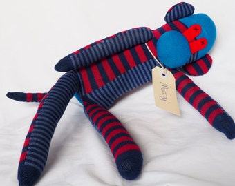 Red blue sock monkey, sock animal, soft plush toy monkey. Murray Monkey.