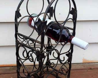 Black wrought iron wine rack (contact us for delivery quote)