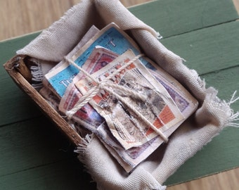 1/12th scale aged old crate filled with old vintage newspapers/comics and tied with string