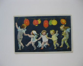 MFL - Artist Signed Post Card - Winged Cherubs with Dog Dancing with Chinese Lanterns - Unused - 1910s